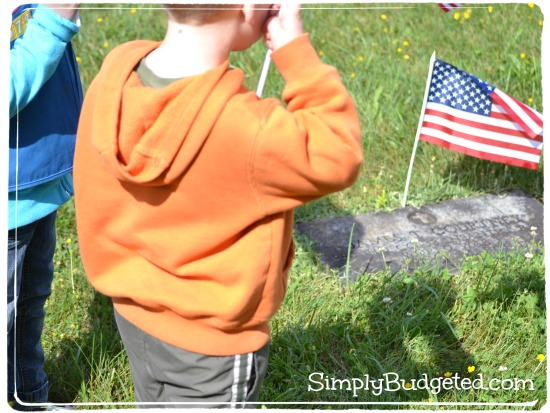 Kids putting out flags for Memorial Day