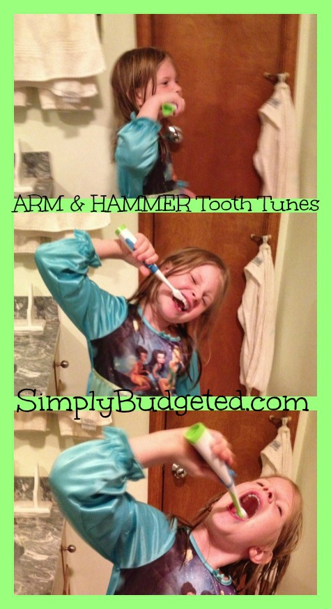 Grace using ARM &amp; HAMMER Tooth Tunes Toothbrush!